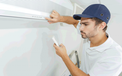 technician-checking-ac-installation-in-clients-bui-P8DW7ZH